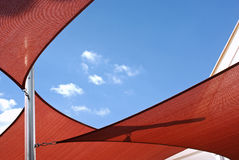 Sunshade sails. Over cloudy blue sky Royalty Free Stock Photography