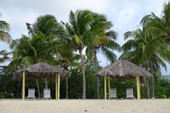 Sunshade Shelters on Sandy Beach Royalty Free Stock Photo