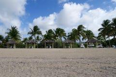 Sunshade Shelters on Sandy Beach Stock Image