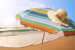 Sunshade and Straw Hat Stock Photos