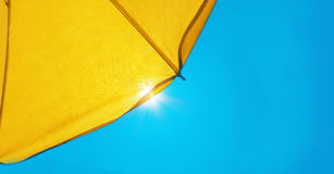 Sunshade with sunshine. Rays in summer Royalty Free Stock Image