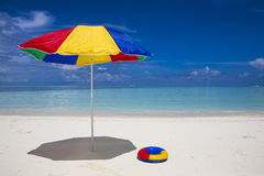 Sunshade and swimming ring Stock Photos