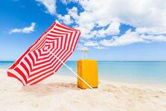 Sunshade and trolley at the beach Stock Image