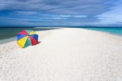 Sunshade on tropical white beach Royalty Free Stock Image