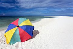 Sunshade on tropical white beach Stock Photography