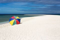 Sunshade on tropical white beach Stock Photos
