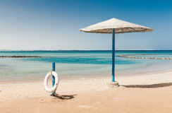 Sunshade umbrellas on the beach Royalty Free Stock Images