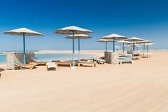 Sunshade umbrellas on the beach Royalty Free Stock Image