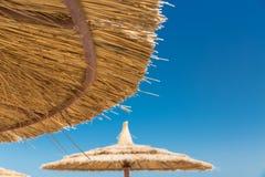 Sunshade umbrellas on the beach Royalty Free Stock Photography