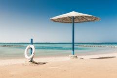 Sunshade umbrellas on the beach Stock Photography