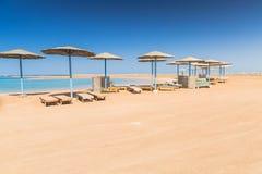 Sunshade umbrellas on the beach Stock Image