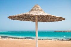 Sunshade umbrellas on the beach Stock Images