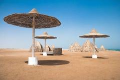 Sunshade umbrellas on the beach Stock Photos