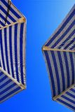Sunshades against the blue sky Royalty Free Stock Photos