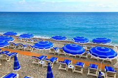 Sunshades on the beach in Nice,Cote d'Azur, France Royalty Free Stock Image