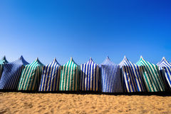 Sunshades in beach at summer against blue sky Royalty Free Stock Images