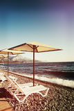 Sunshades and chaise lounges on beach. Summer seascape. Sunshades and chaise lounges on beach. Turkey, Kemer. Beautiful view of mountains and sea stock photos