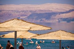 Sunshades on the Dead Sea beach. From Israel Royalty Free Stock Photo