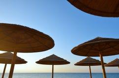 Sunshades. Group of sunshades against the sky blue Stock Photos