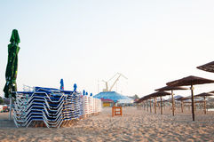 Sunshades and lounges Stock Images