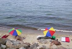 Sunshades on sea shore Royalty Free Stock Image