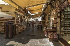 Sunshades, shops and alley Old Town Rhodes. Stock Images