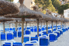 Sunshades and sun loungers on the beach in Majorca Royalty Free Stock Photo