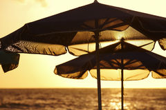 Sunshades at sunset in a mediterranean beach. Crete Royalty Free Stock Photography