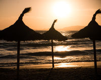 Sunshades at sunset Royalty Free Stock Images