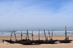Sunshades upside down on the beach Royalty Free Stock Photos