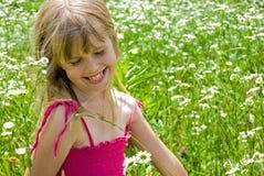 Sunshine. Happy girl in a summer sundress stock image