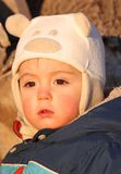 Sunshine. Face of baby in nature during winter Royalty Free Stock Photography