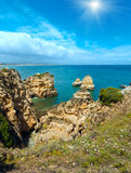 Sunshine above Atlantic rocky coastline (Algarve, Portugal). Stock Photos