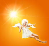 Sunshine Angel. Cute Mixed Media Picture with Woman in Angel Costume Stock Image