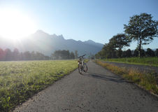 Sunshine on the Bicycle. And switzerland summer view background Stock Image