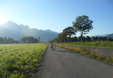 Sunshine on the Bicycle. And switzerland summer view background Royalty Free Stock Image