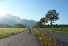 Sunshine on the Bicycle. And switzerland summer view background Stock Images