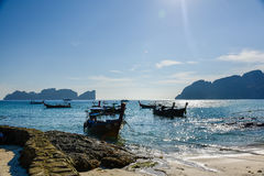 Sunshine on the boat in Phi Phi Island. With a view of the island of Maya Bay in the background Royalty Free Stock Image