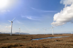 Sunshine and bogland with wind turbines Royalty Free Stock Photography