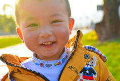 Sunshine boy. Sunny day, holding the baby in the outdoor sun, not only can promote calcium absorption, but also can make your baby grow stronger. To promote Stock Image