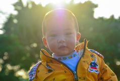Sunshine boy. Sunny day, holding the baby in the outdoor sun, not only can promote calcium absorption, but also can make your baby grow stronger. To promote Royalty Free Stock Photos