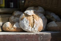 Sunshine Bread. Fresh bread sits in the window of a traditional bakery stock images
