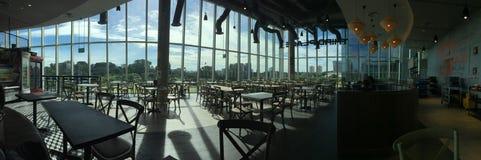 Sunshine through cafeteria windows. Morning sun shine through the glass windows, empty hawker centre cafeteria in the morning royalty free stock photos
