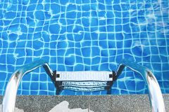 Sunshine on swimming pool. Sunshine and clear water of swimming pool royalty free stock photos