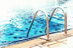 Sunshine on swimming pool. Sunshine and clear water of swimming pool Stock Photography
