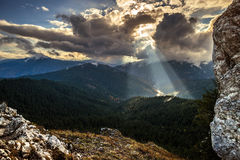Sunshine between the clouds. Coudy day in Carpatians  mountains Stock Photography