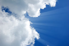 Sunshine from clouds in day. Royalty Free Stock Photo