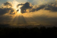 Sunshine through clouds Royalty Free Stock Photography