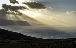 Sunshine through clouds and over the sea near Llandudno, Wales, UK Royalty Free Stock Photography