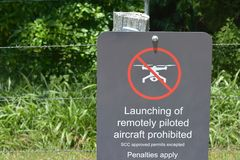 No Drones Allowed Sign on a private property. SUNSHINE COAST - JAN 27 2019:Sign on a fence warning against the use of drones in the area. drone flying royalty free stock photos